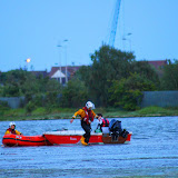 Poole ILB crew members with the tender aground in Holes Bay 6 June 2014 Photo: Scott Rowland, RNLI Poole