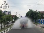 Tim Satgas Covid-19 Polres Lhokseumawe Bersama BPBD Aceh Utara Semprotkan Disinfektan di Dewantara