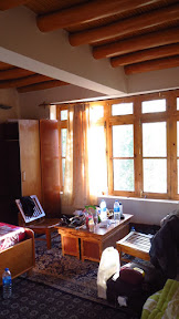 Golden hues of a Ladakhi house, with varnished Poplar trunks in the ceilings