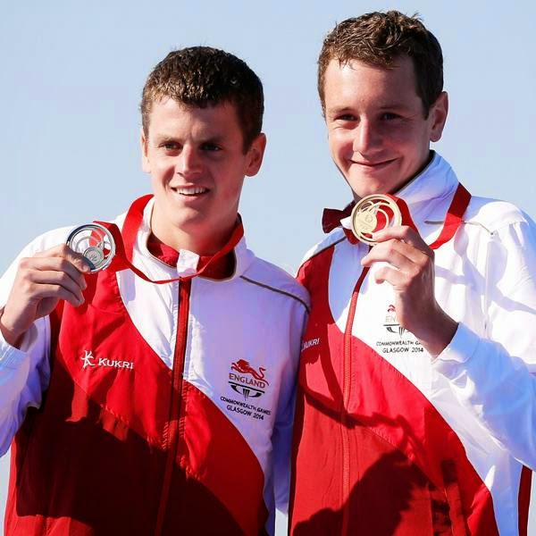 England's Alistair and his brother Jonathan celebrate with their medals following the men's triathlon race at the 2014 Commonwealth Games in Glasgow.