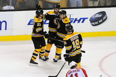 Bruins players celebrate a goal