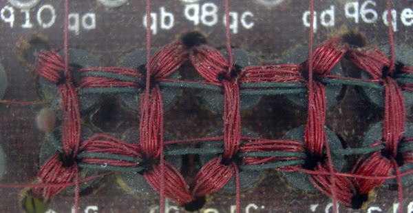 Closeup of the matrix switch used in the IBM core memory. Each ferrite ring drives one of the select lines in the core memory.