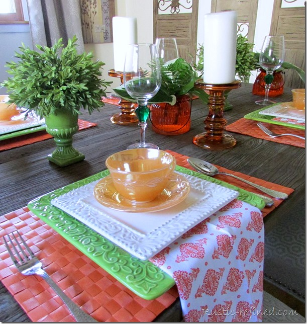Setting a summer tablescape. Using both vintage and modern touches, for a bright colorful dining experience.
