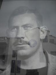 Reflection of the MBA on window of John Steinbeck mural.