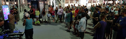 Another typical open-air message at night at the beach. It's tremendous how God sends people from all over to listen!
