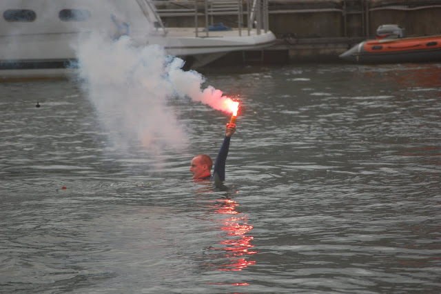 Casualty signalling distress using a hand-held flare