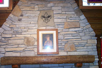 Fireplace mantle with Baden Powell's picture