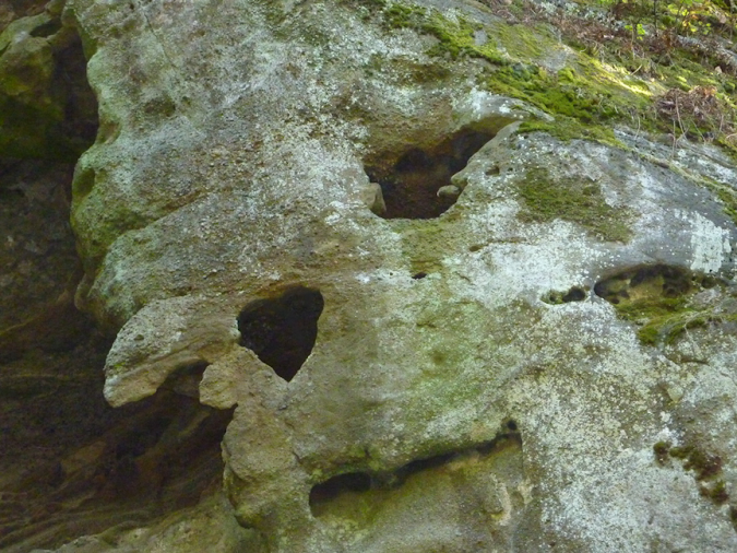 Heart-shaped hole in prehistoric rock along Englishman River north of Nanaimo, BC