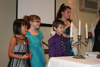Vivienne blessing her siblings.