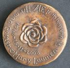 Achterkant bronzen herdenkingspenning, veertigjarig huwelijk. Diameter 9 cm.