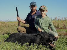 Mr Michael Trovato and his son with an old wild boar taken with a double rifle 450/400