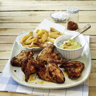 Chicken Wings, Fries and Guacamole.