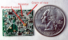 Apple iPhone charger circuit board compared to a mustard seed, grain of rice, and quarter.