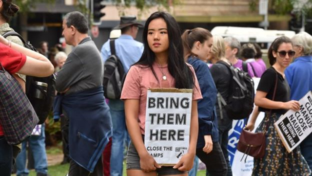Protesters in Australia demand that refugees being held in detention on the Pacific island of Nauru be brought to Australia. Photo: Getty Images