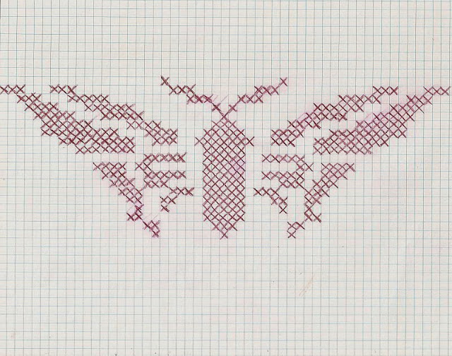 butterfly cross-stitch pattern in transfer pencil on graph paper