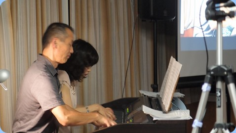 Club Member, Taka Iida, who kindly oranized for Reiko to play for us is seen here doing a duet with Reiko. Photo courtesy of Dennis Lyons.