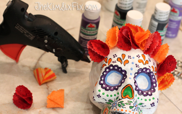 Gluing flowers onto skull