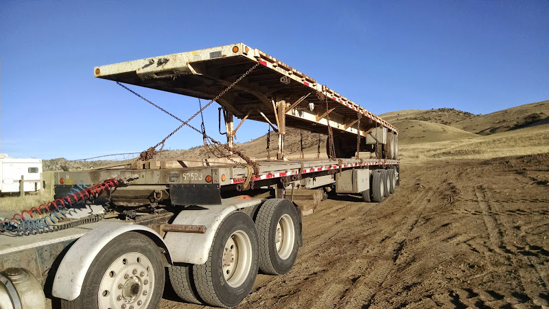flatbed trailer loaded on extended trailer in Montana