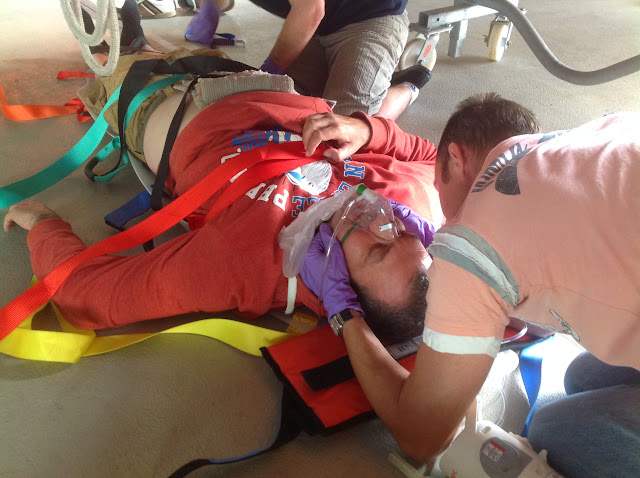 Mark reassuring the casualty (Rich) while maintaining a jaw thrust and providing free-flow oxygen - July 2014 Photo: Dave Riley