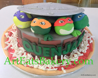 Unique Teenage Mutant Ninja custom kid's birthday cake with handmade fondant turtle heads, pizza and edible silver manhole cover