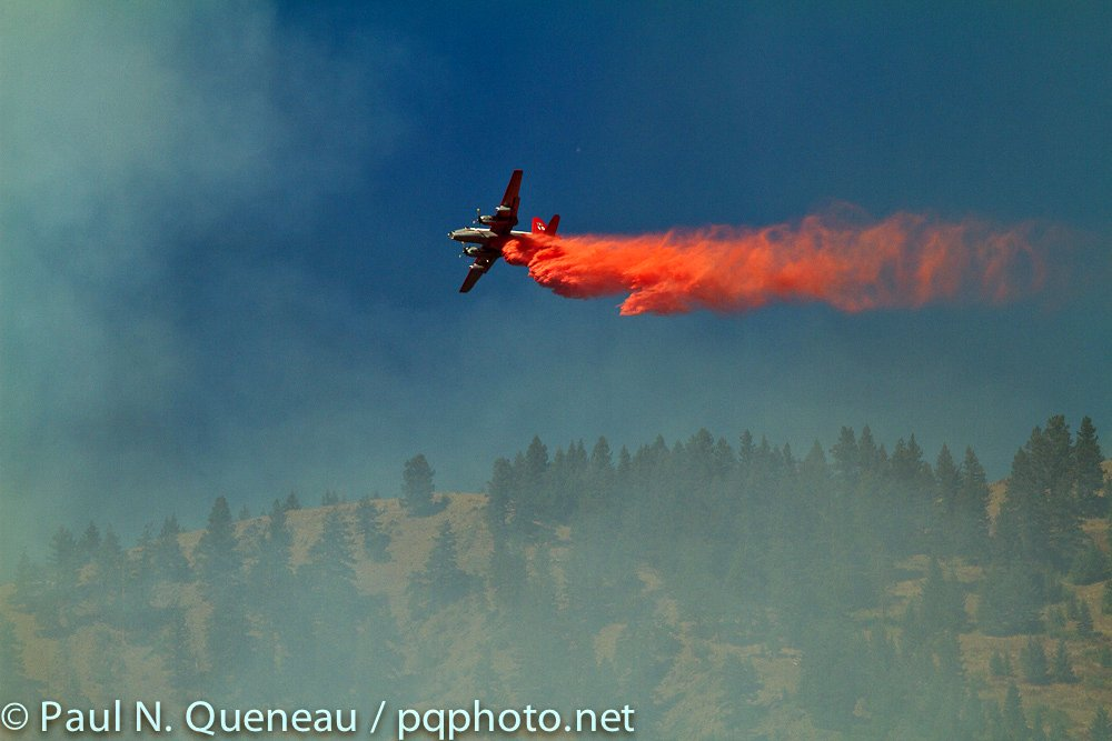 A heavy bomber from Neptune Aviation in Missoula attempts to douse the flames of the West Riverside Fire above Bonner on August 23, 2011.