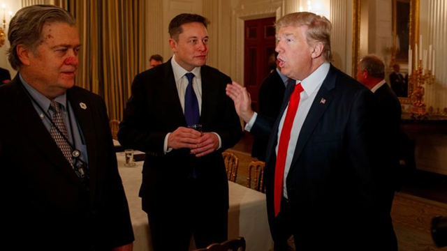 Trump talks with Tesla and SpaceX CEO Elon Musk, center, and White House strategist Steve Bannon during a meeting with business leaders at the White House on 3 February 2017. Photo: Evan Vucci / Associated Press