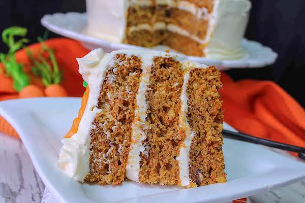 A Slice Of Addictive Carrot Cake On A Plate.