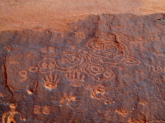 Handprints, hoofprints, lines, circles