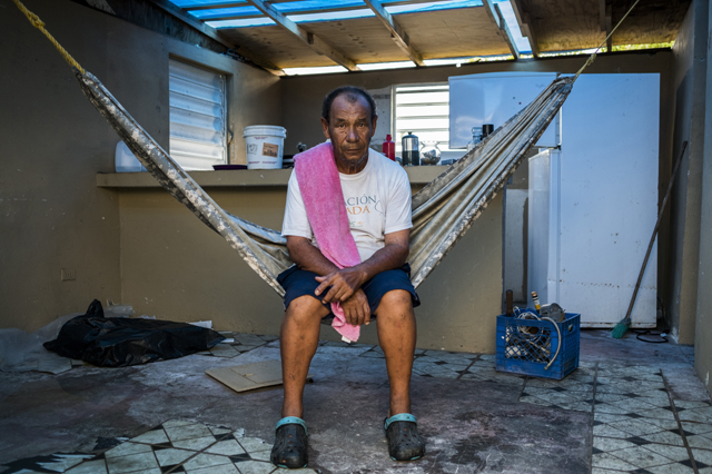 Pablo Figueroa, of Punta Santiago in Puerto Rico, keeps his belongings wedged into a corner of his home, the only spot where the roof remains after Hurricane Maria destroyed his home. Photo: The New York Times