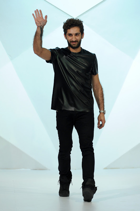 DUBAI, UNITED ARAB EMIRATES - APRIL 11:  Designer Jean Louis Sabaji appears at the end of the runway after the Jean Louis Sabaji show during Fashion Forward at Madinat Jumeirah on April 11, 2014 in Dubai, United Arab Emirates.  (Photo by Stuart C. Wilson/Getty Images for Fashion Forward) *** Local Caption *** Jean Louis Sabaji