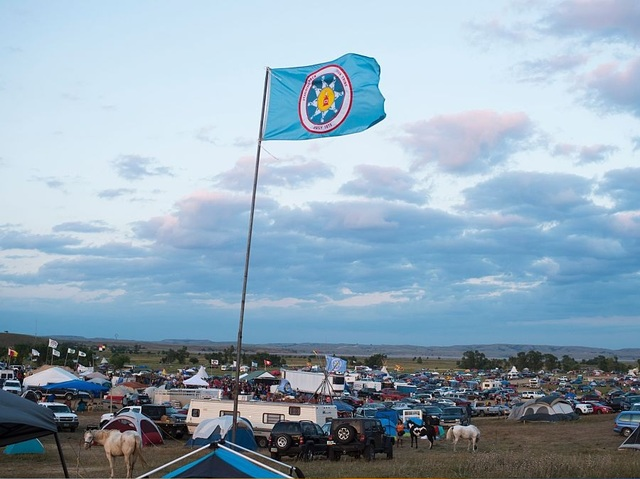 The flag of the Standing Rock Sioux tribe flies over the encampment of the Dakota Access pipeline protesters in North Dakota. Photo: Robyn Beck / AFP / Getty Images