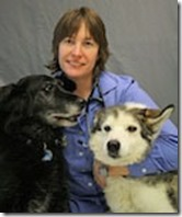 Dr. Meezie with her pups, picture from soldotnaanimalhospital.com