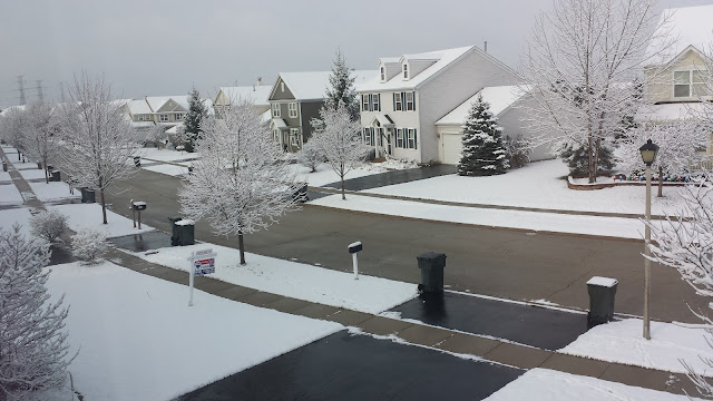Snowy neighborhood with melted roads in Chicagoland suburbs on December 2, 2015