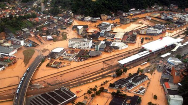 Aerial view of flooding in São Paulo, 13 March 2016. Torrential rains killed at least 20 people on the outskirts of the Brazilian economic capital. Photo: AFP