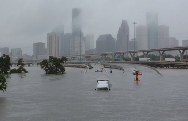 Interstate highway 45 is submerged from the effects of Hurricane Harvey seen during widespread flooding in Houston, Texas on 27 August 2017. Photo: Richard Carson / REUTERS