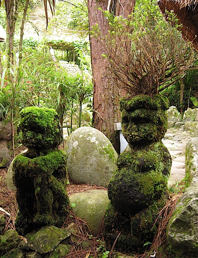 two moss-covered stone bulol in Tam-awan Village in Baguio City
