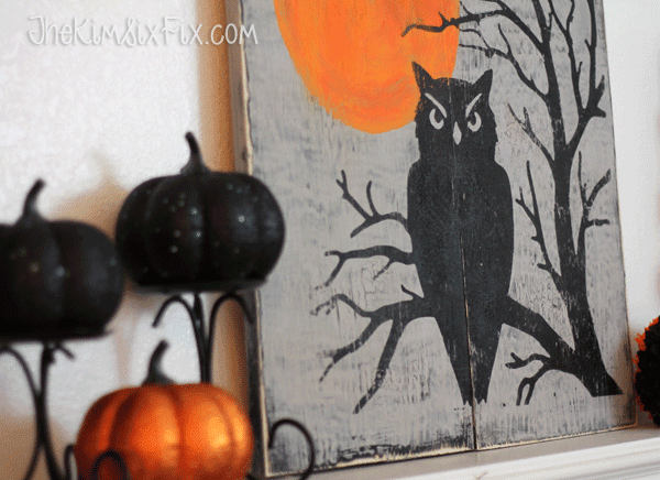 Black and orange pumpkins and owl mantel