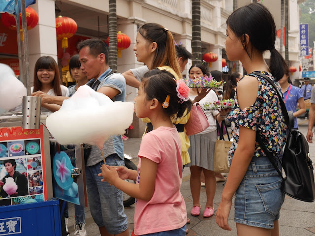 girl eating cotton candy in Zhongshan, Guangdong