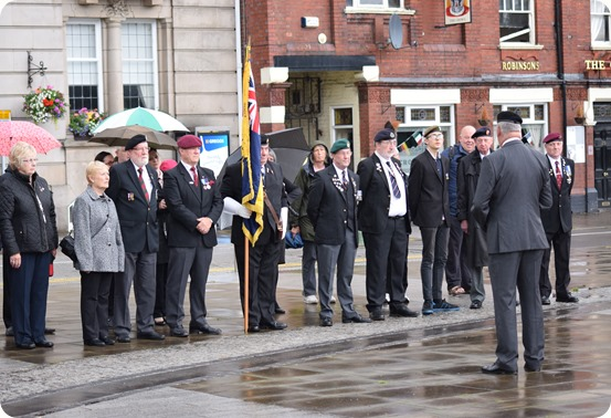 Royal British Legion Crewe branch and members of public  prepare for two minute silence