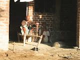 Old men of Amarpurkashi enjoy smoking the traditional hookah