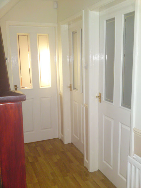 Pure Brilliant white doors painted as part of Hall,Landing and stairs