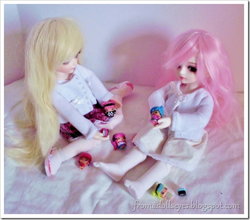 "Two ball jointed dolls playing with their ""dolls""."
