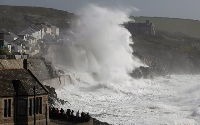 Huge waves whipped up by Storm Ophelia batter the coast at Porthleven in Cornwall, 17 October 2017. Photo: APEX