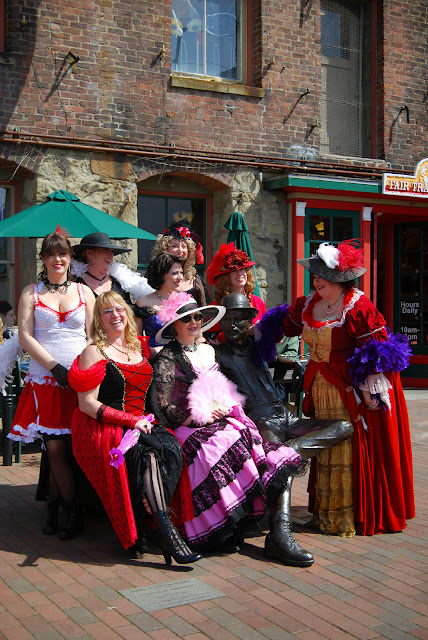 Women dressed up as harlots around Dirty Dan statueCredit: Bellingham Whatcom County Tourism
