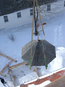 The posts of the octogon show evidence that there had originally been a spire atop the church before this small roof.