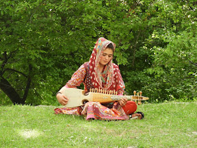 A female playing rabab in Hunza Valley.