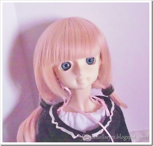 A ball jointed doll after getting her bangs trimmed.