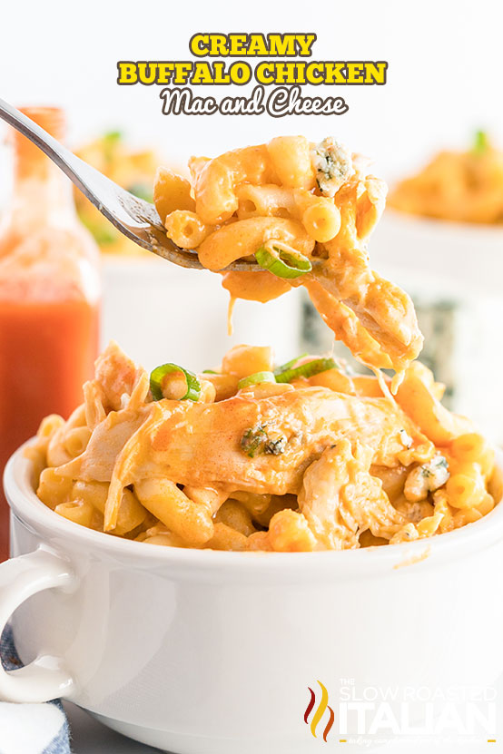 buffalo chicken mac and cheese on a fork with a bowlful beneath