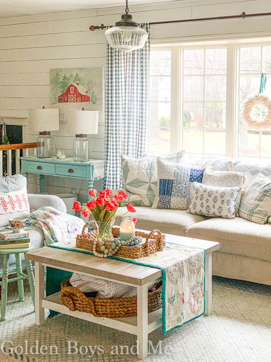 Cottage style living room with quilts and Ikea hack coffee table- www.goldenboysandme.com