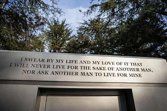 "Atlas Shrugged movie photo; mausoleum engraved ""'I swear by my life and my love of it that I will never live for the sake of another man, nor ask another man to live for mine"""